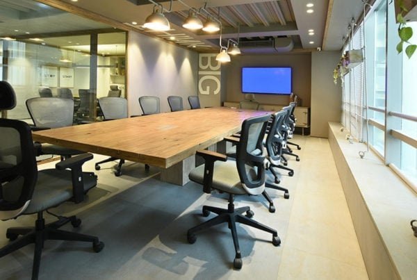 Office with long table and chairs